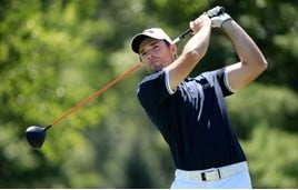 Golfer Oliver Wilson in action