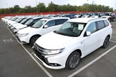 Facelifted Mitsubishi Outlander PHEVs parked in rows