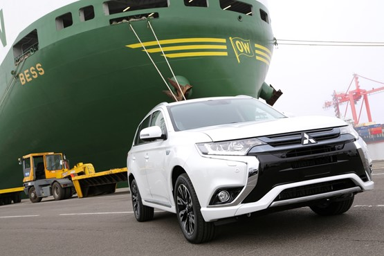 Mitsubishi Outlander PHEV at Bristol docks in the shadow of a container ship