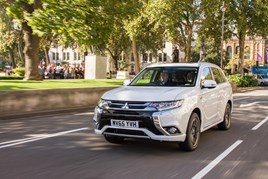 Mitsubishi Outlander PHEV in a leafy London street