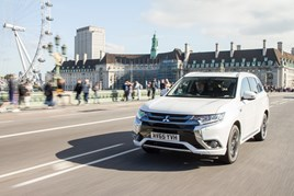 Mitsubishi Outlander PHEV crosses the Thames in front of the London Eye