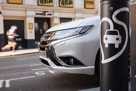 Mitsubishi Outlander PHEV 2015 in London street by charging point