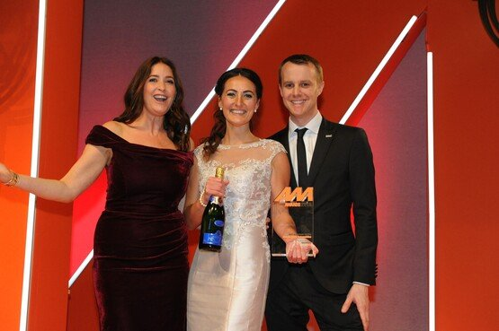 A presentation of a winner's trophy at the 2019 AM Awards