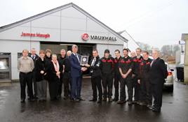 Jim Haugh, managing director of James Haugh (Castle Douglas) receives the Vauxhall award from Peter Hope, Vauxhall customer experience director for Vauxhall Motors UK and Ireland in 2015