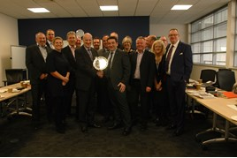 Ken Moore, regional aftersales manager Seat UK receives a trophy from Keith Kingham with manufacturer staff