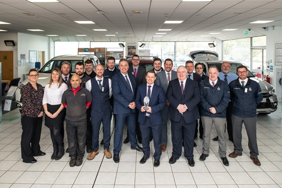 The team at CCR Motor Company's Bristol Mitsubishi dealership celebrate winning the network's 2019 Dealer of the Year award
