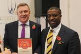 David Rye, managing director, Premier Ford, left, accepts the AM Best UK Dealerships  to Work For award from LTK Consultants'  managing director, Andrew Landell