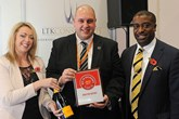 Darren Bradford, general manager,  Drayton Motors Kia, left, accepts the  AM Best UK Dealerships to Work For  award from LTK Consultants'  managing director, Andrew Landell