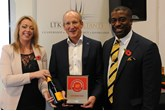 Clive Brook, managing director, Clive Brook Volvo, centre, accepts the AM Best UK  Dealerships to Work For award from LTK Consultants' managing director, Andrew  Landell, and operations director Vanessa Kendrick