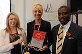 Stacey Turner, HR and legal director, Chorley Nissan, centre, accepts the AM Best UK  Dealerships to Work For award from LTK Consultants' managing director,  Andrew Landell, and operations director Vanessa Kendrick