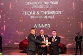 Flear and Thomson's Scott Buchanan collects the group's 'dealer of the year' award from Paul Philpott, president and chief executive of Kia Motors UK