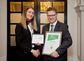 Accountant Malwina Bartosiak receives her award from Vertu Motors chief executive Robert Forrester