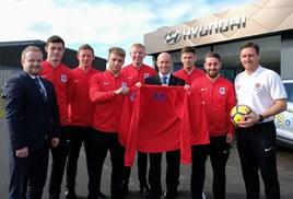 Seaham Red Stars players meet the team from Bristol Street Motors Hyundai Peterlee, including general manger Paul Walton (centre)