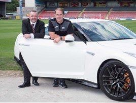 Paul Jordan, aftersales manager from Macklin Motors Glasgow Nissan Central, with Alan Archibald, Partick Thistle manager