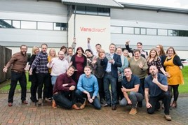 Richard Simmonds, managing director of Vansdirect (front with award) with the team