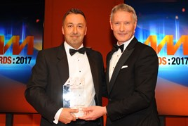 John Luck, general manager, Yeomans Toyota Brighton, collects the award from Mark Gow, sales director, DSG Finance