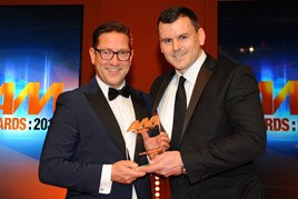 Jason Cranswick, commercial  director, Jardine Motors Group (left), collects the AM Award 2017 for excellence in customer service from John O'Donnell, managing director, Emac