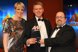 Paul Philpott, president and chief executive, Kia Motors UK, collects the AM Award 2017 for franchise partner of the year from AM editor Tim Rose