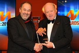 Robin Luscombe, managing director, Luscombe Motors, (left) collects his AM Awards 2017: Best use of video from chairman of the judges Christopher Macgowan