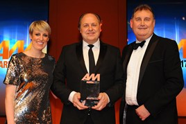 AM Awards host, Stepg McGovern, left, Philip J Deacon, centre, head of marketing, Marshall Motor Group, collects the award for Digital Initiative of the Year from Darren Moon, sales director, Auto Trader, right.