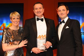 Peter Allibon, sales director, Mazda, collects the AM Award 2017 for manufacturer of the year from James Hind (right) chief executive and founder, Carwow