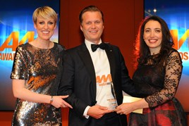 Peter Vardy, chief executive of Peter Vardy, collects the AM Award 2017 for retailer of the year from Nagla Thabet, head of franchise and leisure, Black Horse (right)