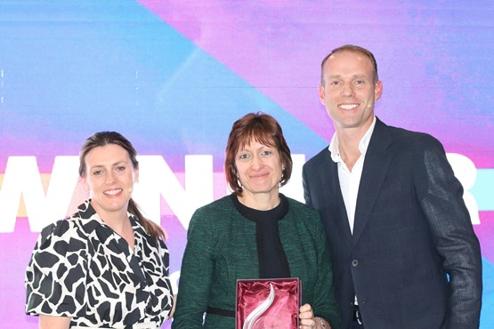 Alison Jones (centre), receives the Barbara Cox Woman of the Year Award from Alison Fisher and Martin Forbes