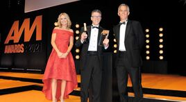 Huw Roberts, group people director, Peter Vardy, collects the award from Steve Le Bas, head of motor retail, and TV presenter Charlotte Hawkins