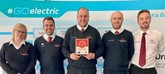 The team at Drayton Motors proudly display their Best UK Dealerships to Work For awards
