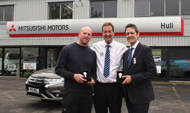 Hull Mitsubishi's managing director Jim Clutterbrook congratulates Andrew Roebuck (left) and Andrew Iveson