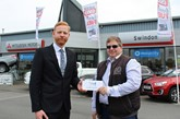 CCR's Andy Jackman presents shopper Gary Broom with his prize