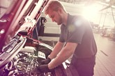 An automotive apprentice at work