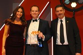 Arran Bangham, group vice-chairman,  RRG Škoda, accepts the award from Darren  Preddy, director – dealer sales, Rapid RTC, right and host Lisa Snowdon, left