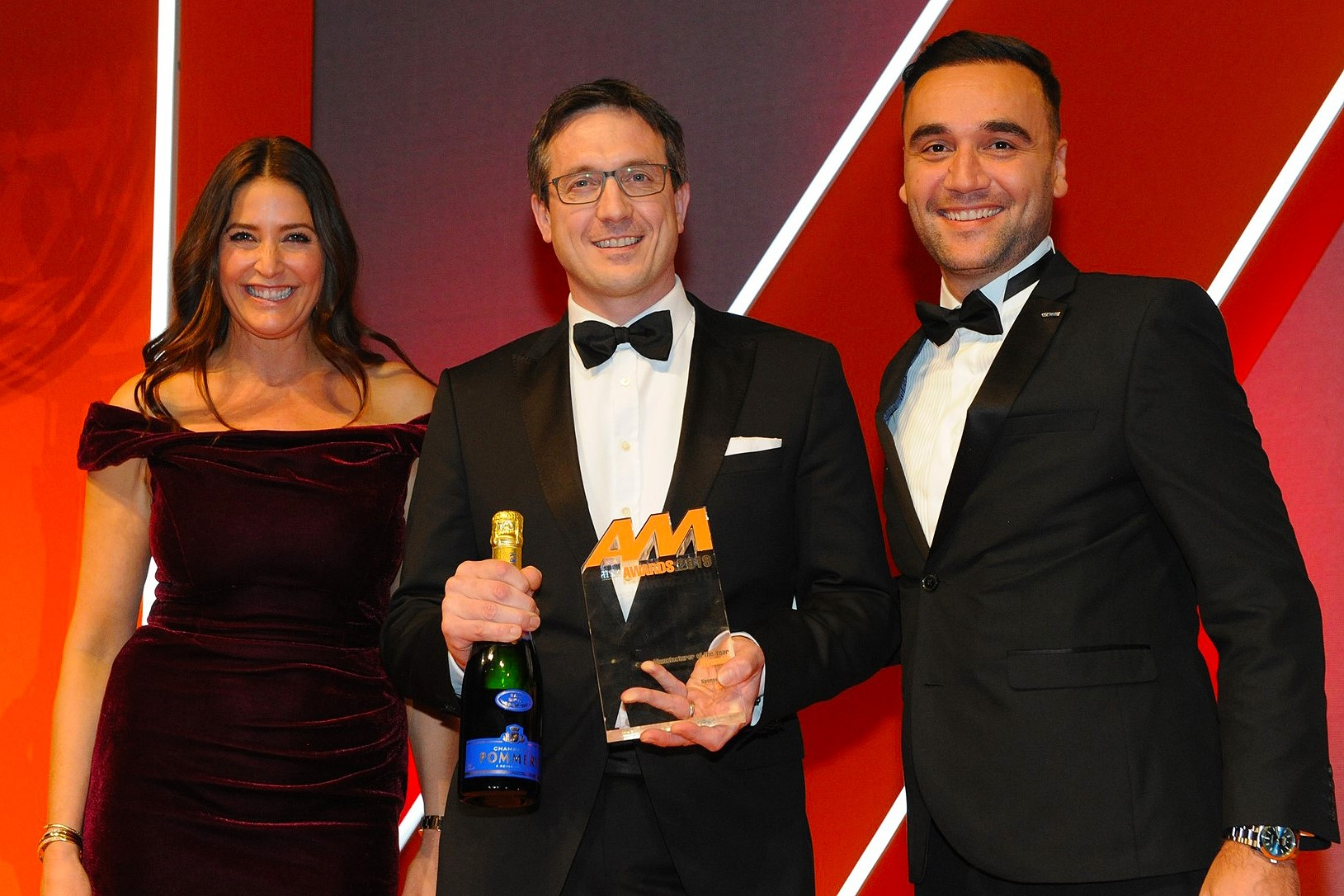Ashley Andrew, managing director, Hyundai Motor  UK, accepts the award from Hasan Nergiz, head  of OEM and agency strategy, Carwow, right, and host Lisa Snowdon
