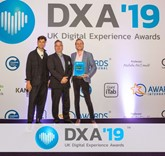 Tom Mapes (far right), Aston Barclay's group marketing and PR manager, receives the gold award from the Digital Experience team