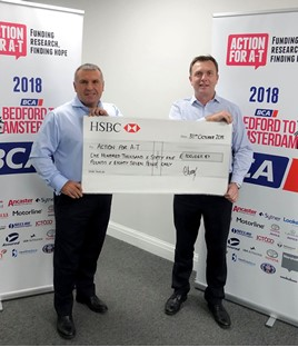 BCA's chief commercial officer Craig Purvey formally handed over a cheque to Sean Kelly, chief executive, Action for A-T at BCA Blackbushe late last month (pictured).