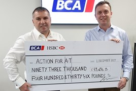 BCA chief commercial officer Craig Purvey (left) presents the cheque to Sean Kelly, Chief Executive, Action for A-T