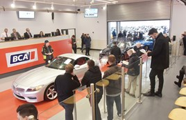 Cars pass through a BCA auction hall in February