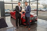 Class: Mercedes-Benz's Krishan Bodhani receives the E-Class' Car of the Year accolade from John Challen