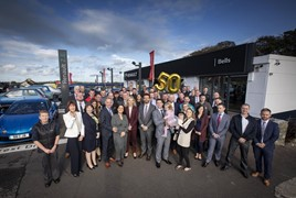 The team at Bells of Crossgar welcome Groupe Renault UK managing director, Vincent Tourette, and network operations director, Louise O'Sullivan, to celebrate 50 years with the brand