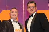 Ben Scholes, communications and content manager, CarShop, collects the award from Jeremy Evans, managing director, Marketing Delivery, right