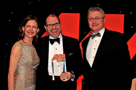 Former Benfield Motor Group chief executive Mark Squires, centre, accepts his award from host Katie Derham and Jonathan Ellis, UK sales manager lubricants, Shell Oil