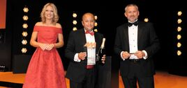 Marshall Motor Group chief  executive Daksh Gupta (centre) collected the award from Tim Pearcey, sales director of Keyloop