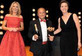 Marshall Motor Group CEO Daksh Gupta receives the award from heycar chief commercial officer Karen Hilton