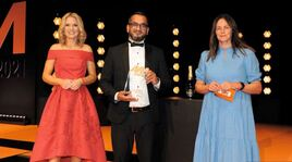 Ish Hussain, general manager, Steven Eagell Toyota Milton Keynes, collects the award from Auto Trader sales director Rebecca Clark (right)