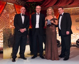 Cox Motor Group's Helen Hayton receives the Dealer of the Year award from Phil Crossman (left), David Hodgetts (centre) and Phil Webb