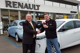 Customer David Wallace receives his new Renault ZOE from Brayleys' Graham Glover.