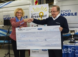 Breakout for Ben: Ben chief executive, Zara Ross, accepts the cheque from TrustFord chairman and chief executive, Stuart Foulds