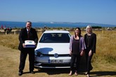 Martin Pye and Jennie Mitchell recreate a 2004 photograph with Café Riva owner, Becky Green as they sold their 20,000 vehicle.