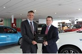 Toby Marshall, marketing director at Mitsubishi Motors in the UK, presents the long-service award to Chris Green, CCR Motor Co regional general manager
